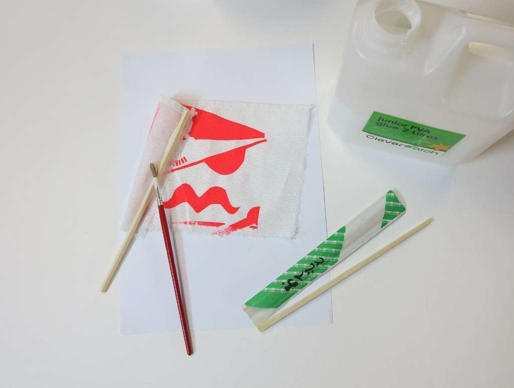 Step  7: Add some PVA glue to a chopstick and roll the glue end around the fabric edge to make a flag