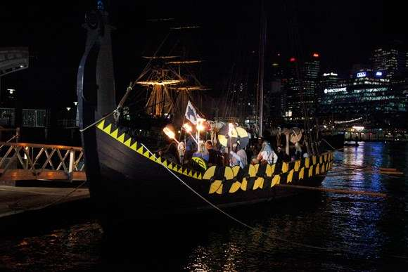 Viking boat on water at night