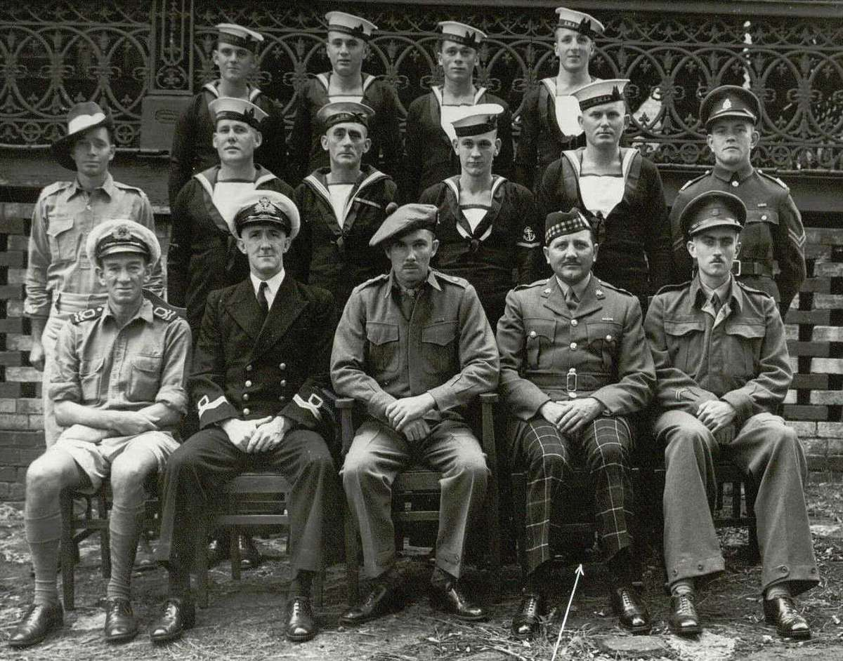 The men of Operation Jaywick. Backrow: AB  Mostyn Berryman, AB Frederick Walter Lota Marsh, AB Arthur Walter Jones, AB Andrew William George Huston. Centre: Cpl Andrew Anthony Crilly, LS Kevin Patrick Cain, LDGSTO James Patrick McDowell, L/TEL Horace Stewart Young, AB Walter Gordon Falls, Cpl Ronald George Morris. Front: Lt Hubert Edward Carse, Lt Donald Montague Noel Davidson, Major Ivan Lyon, Major H A Campbell (did not accompany the expedition), Lt Robert Charles Page.