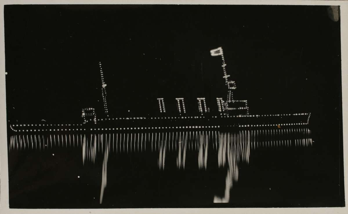 HMAS Sydney illuminated on Sydney Harbour on 4 October 1913 ANMM Collection Gift from Margaret Kiley-Balas