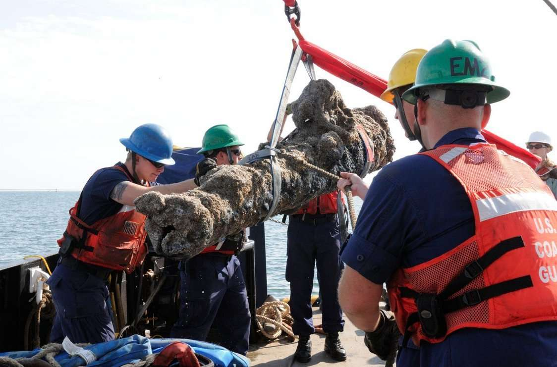The crew of the Coast Guard Cutter Smilax worked with personnel from the North Carolina Department of Cultural Resources to recover five cannons and multiple barrel hoops from the Queen Anne