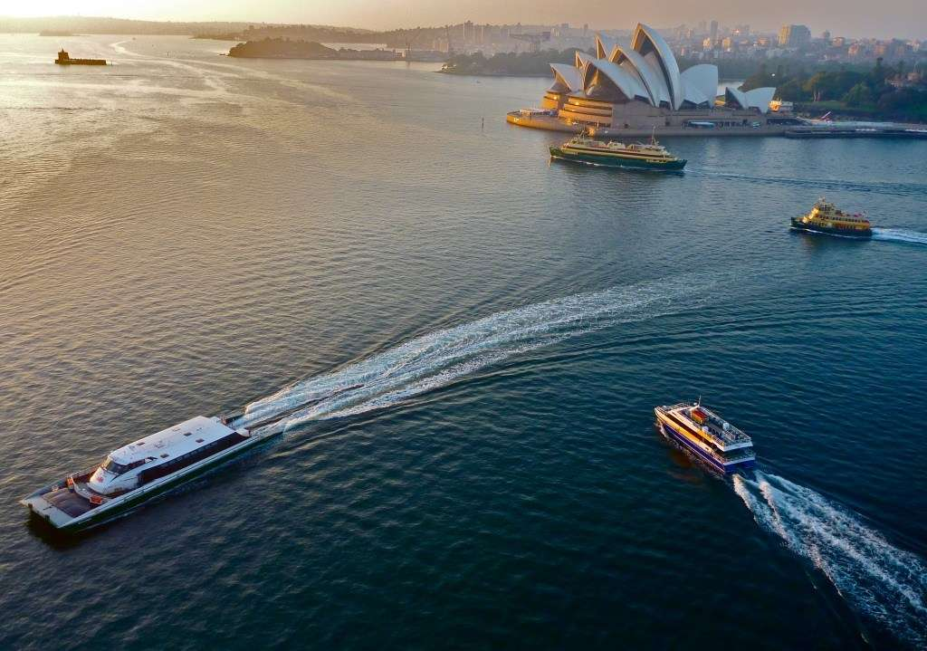 View of Sydney Harbour from bridge, with Opera House and ferries in scene