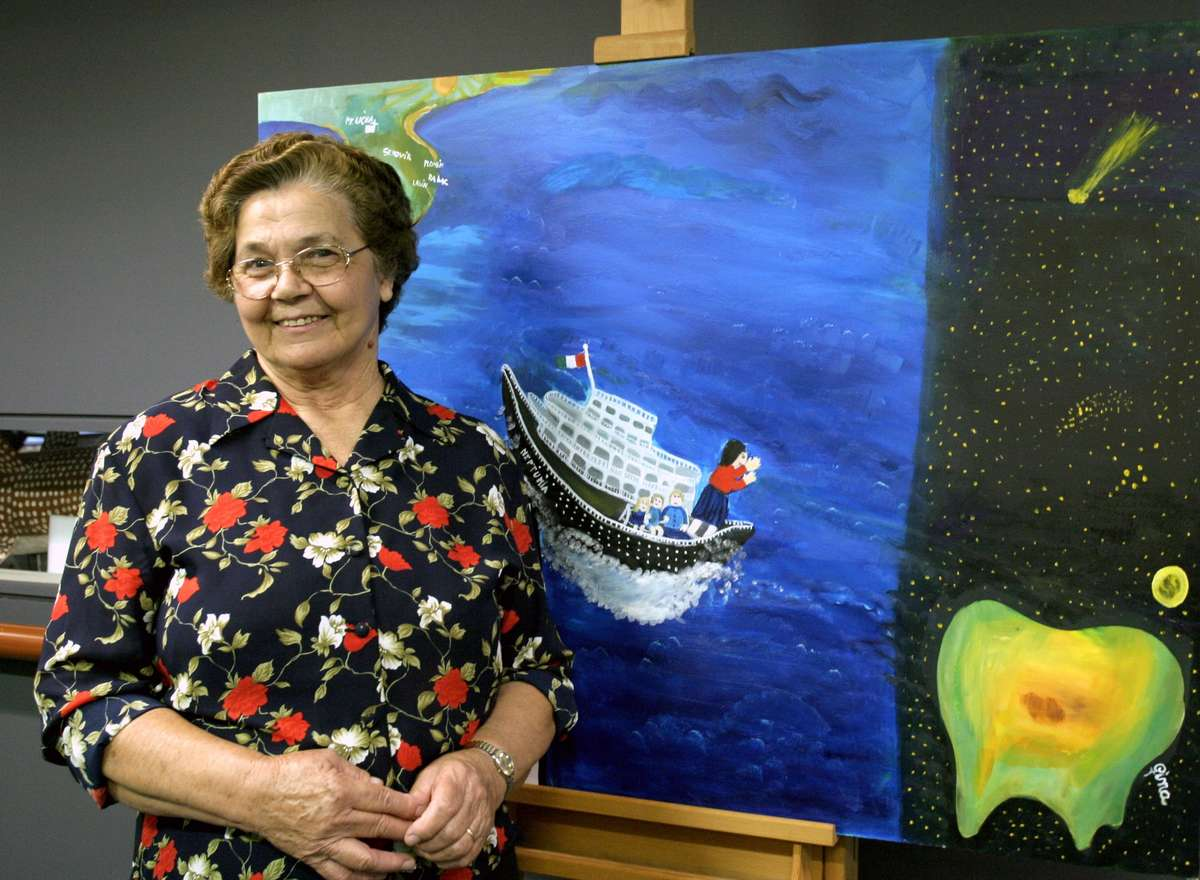Gina Sinozich with her painting Our story, 2005