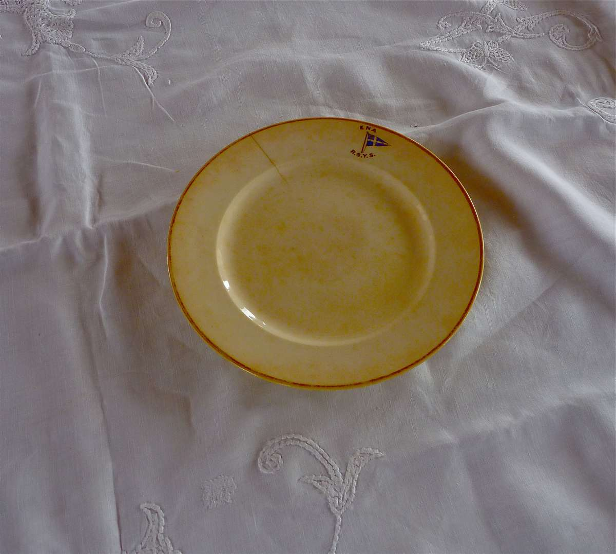 The plate on the embroidered cloth