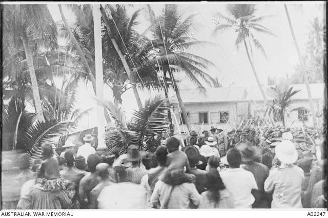 Raising the flag ceremony formalising the occupation of the island of Nauru, 7 November 1914. Australian War Memorial