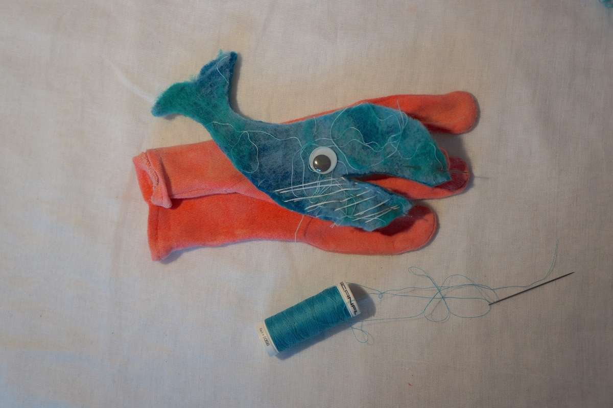 stitch whale on glove