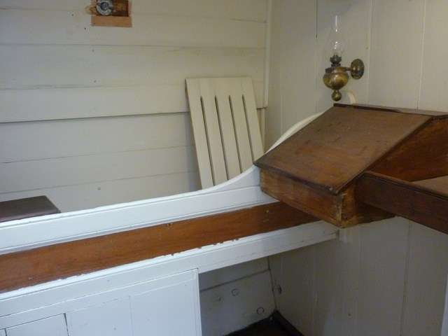 First Mate's Cabin showing the writing slope and lamp for keeping the log.