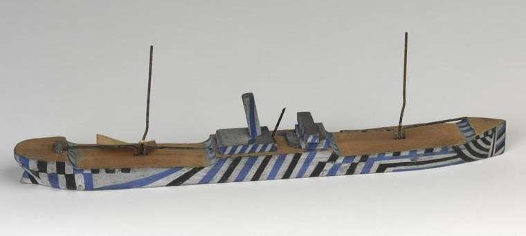 A painted wooden waterline ship model created during WWI to test dazzle paint schemes. Imperial War Museum Collection
