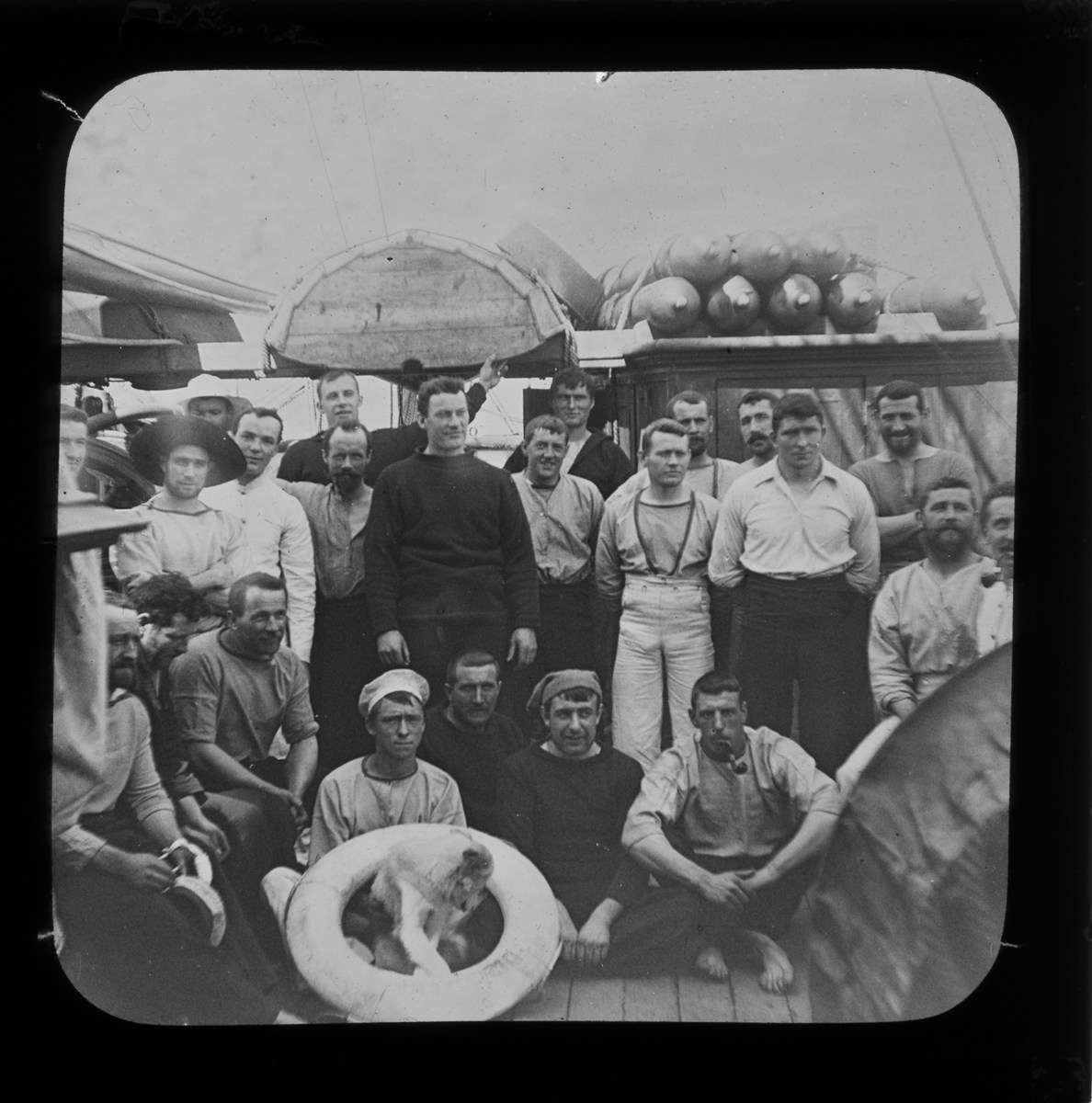 ANMM Collection Crew and dog aboard the Discovery on their way to  in 1901.