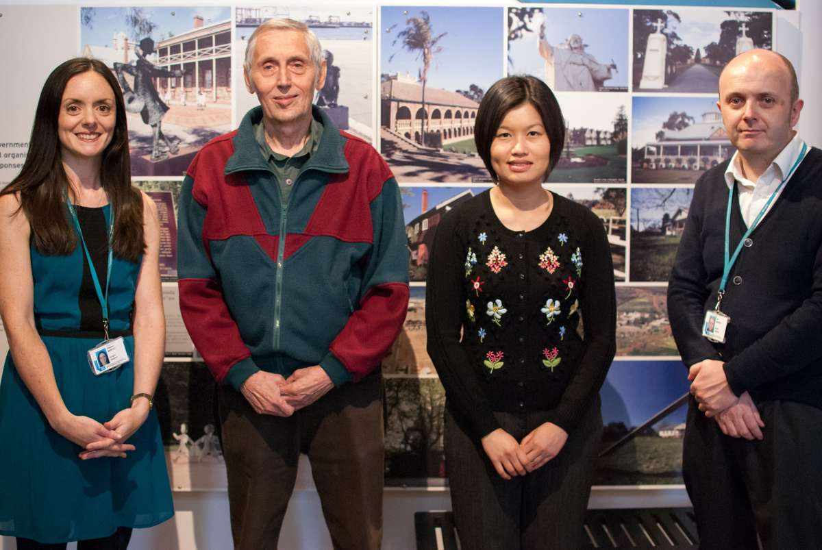Former child migrant Tony Chambers (second from left) with Merseyside curator Ellie Moffat, ANMM curator Kim Tao and Merseyside deputy head Ian Murphy in Liverpool, 2014