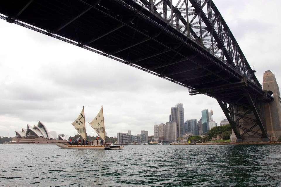 Samoan vaka Gaualofa passes under Sydney Harbour Bridge.