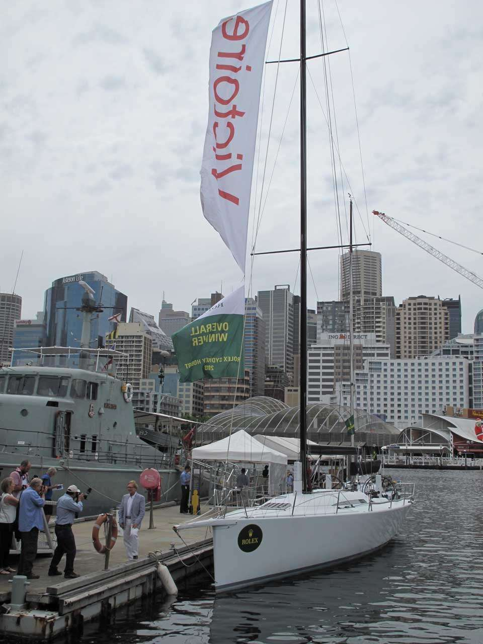 2013 overall winner Victoire, with its skipper Darryl Hodgkinson to the left