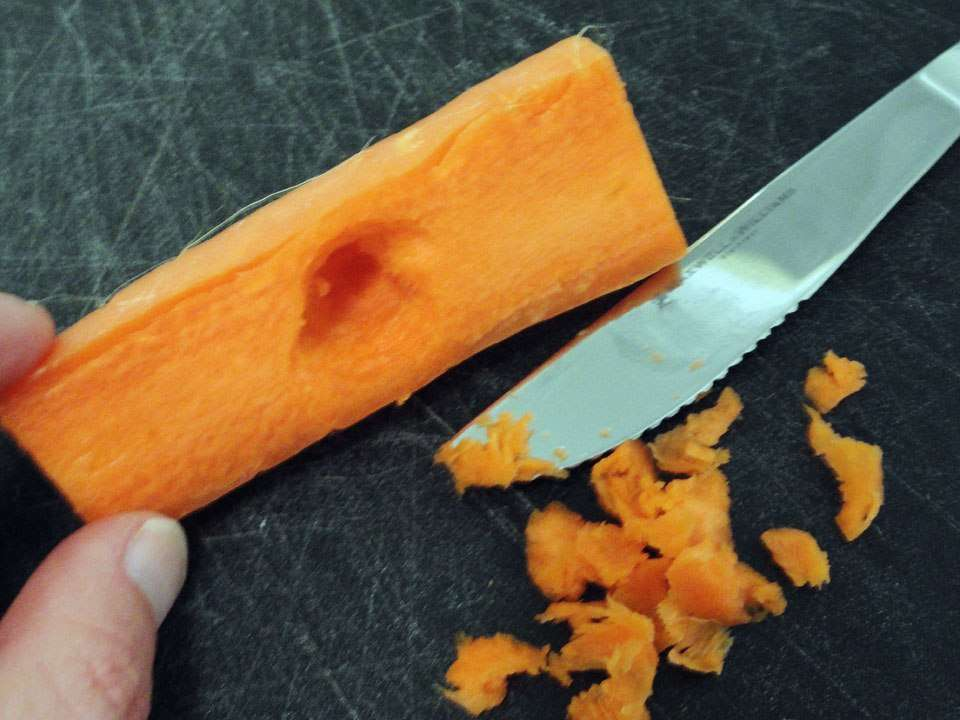Making a hole in the carrot submarine