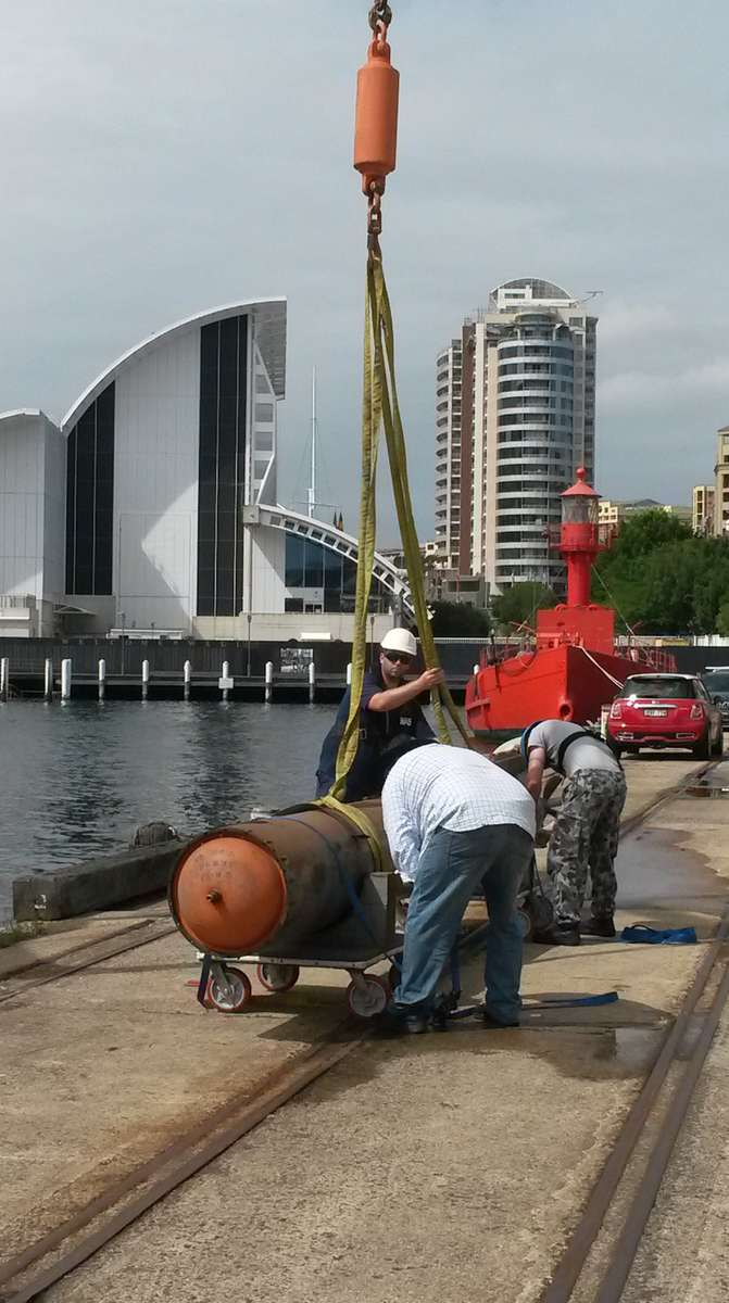 Securing the sling on the torpedo at Wharf 7.