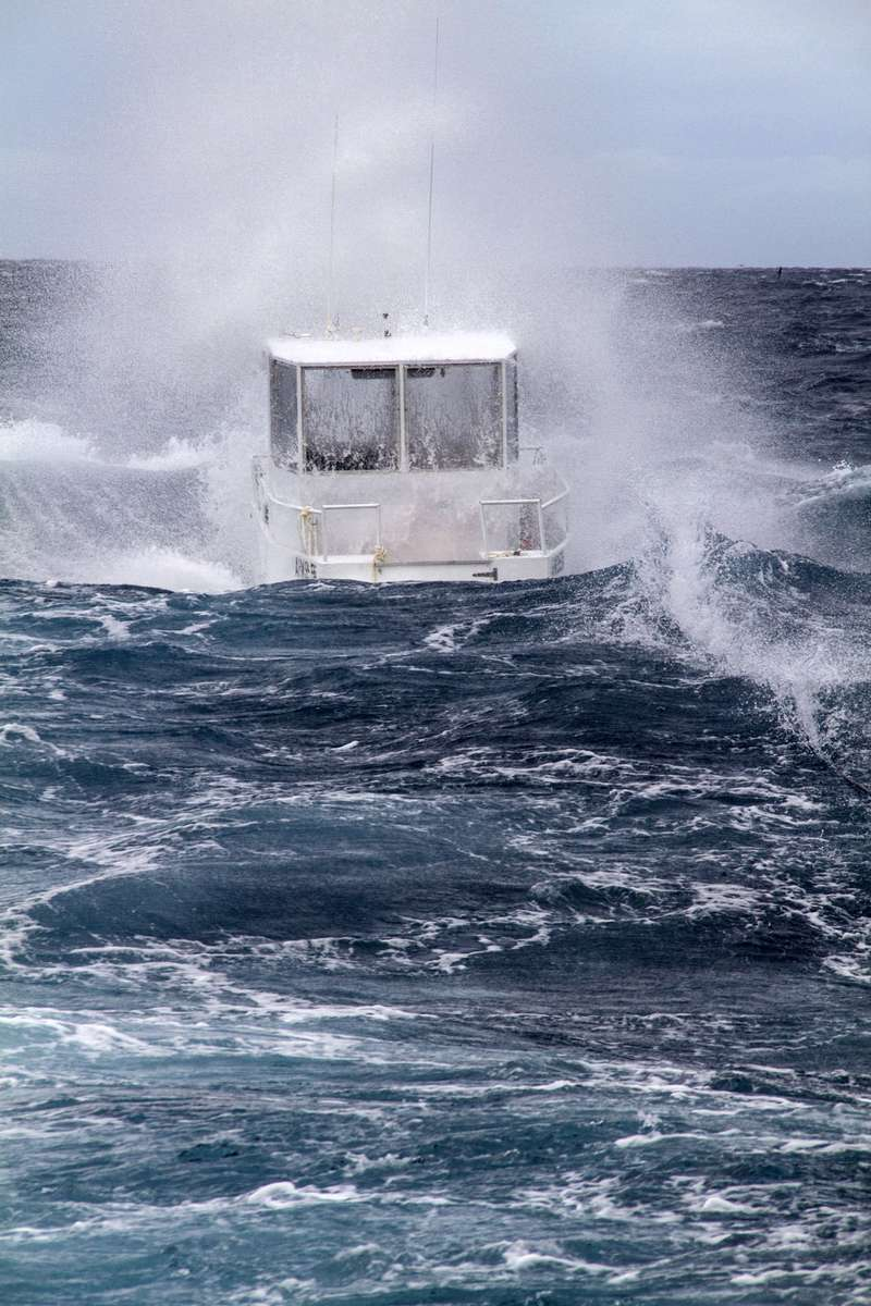 The boat Maggie II in the waves on Ashmore Reef