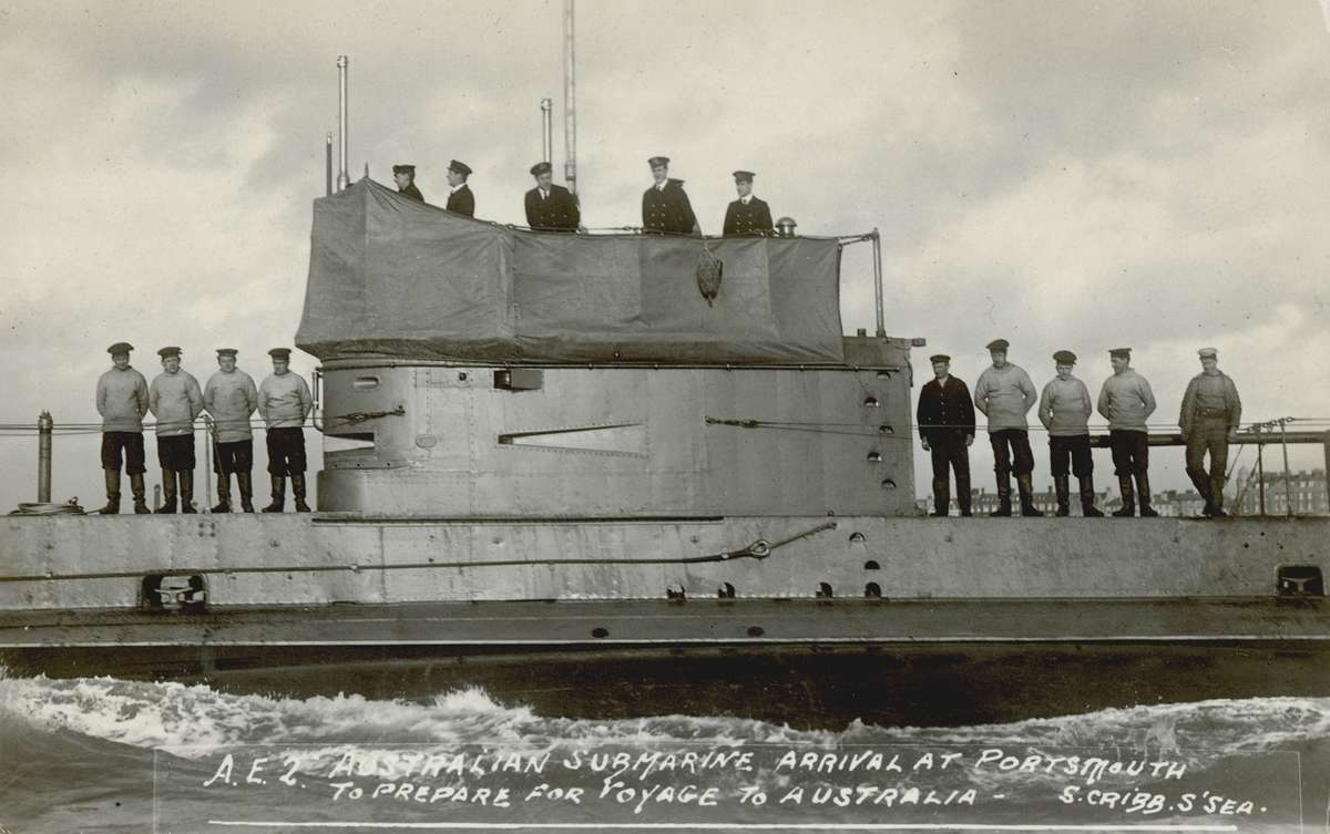 A postcard showing the crew of the newly completed submarine HMAS AE2 in Portsmouth in early 1914. It was sent by Lieutenant Geoffrey Haggard to a relative in London.