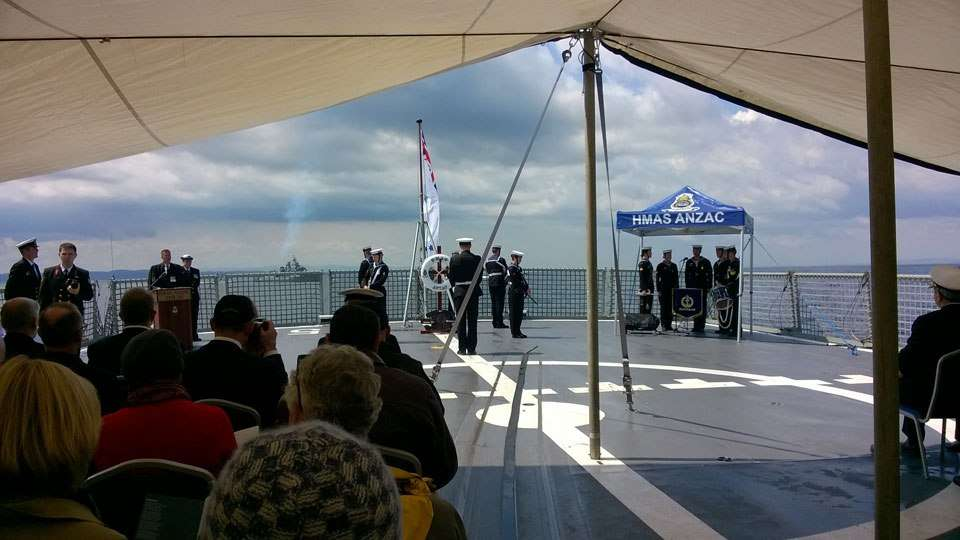 HMAS Anzac's chaplain, Rainer Schack RAN, reads the opening prayer during the AE2 commemoration ceremony.