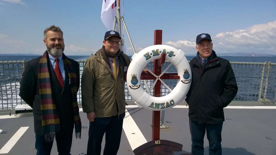 ANMM staff stand on the stern of HMAS Anzac after the AE2 commemoration ceremony. Left to right: Dr James Hunter (Curator, RAN Maritime Archaeology), Kevin Sumption (Director), and Dr Nigel Erskine (Head of Research).