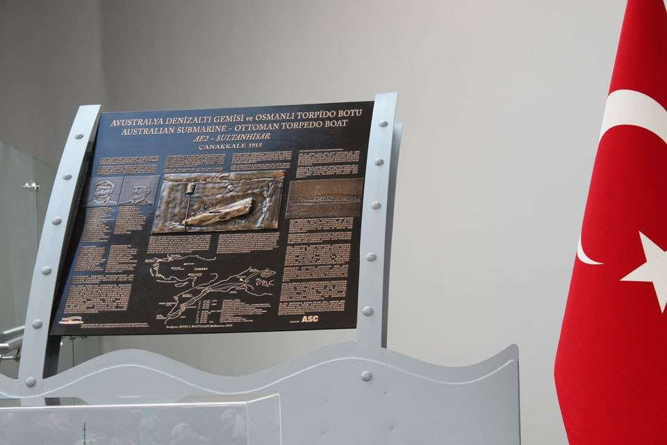 The plaque commemorating the engagement between AE2 and Sultanhisar after being unveiled at Kabatepe Simulation Centre.
