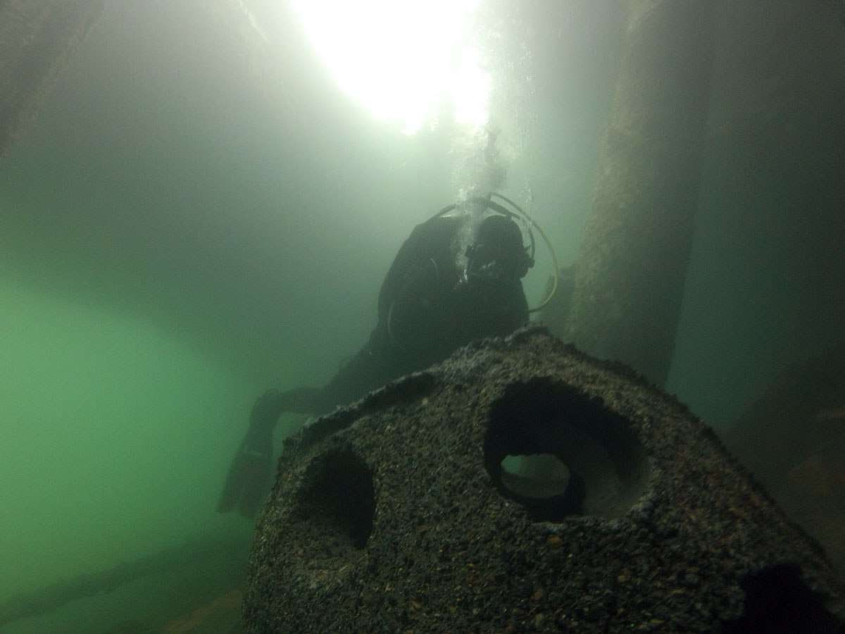 James Hunter guides one of the Reef Balls under the Australian National Maritime Museum's north wharf. Photo: Lee Graham.