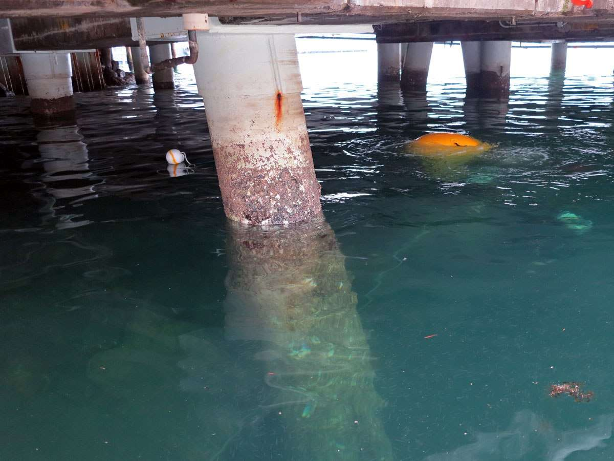 The yellow lift bag is visible on the water surface underneath the museum
