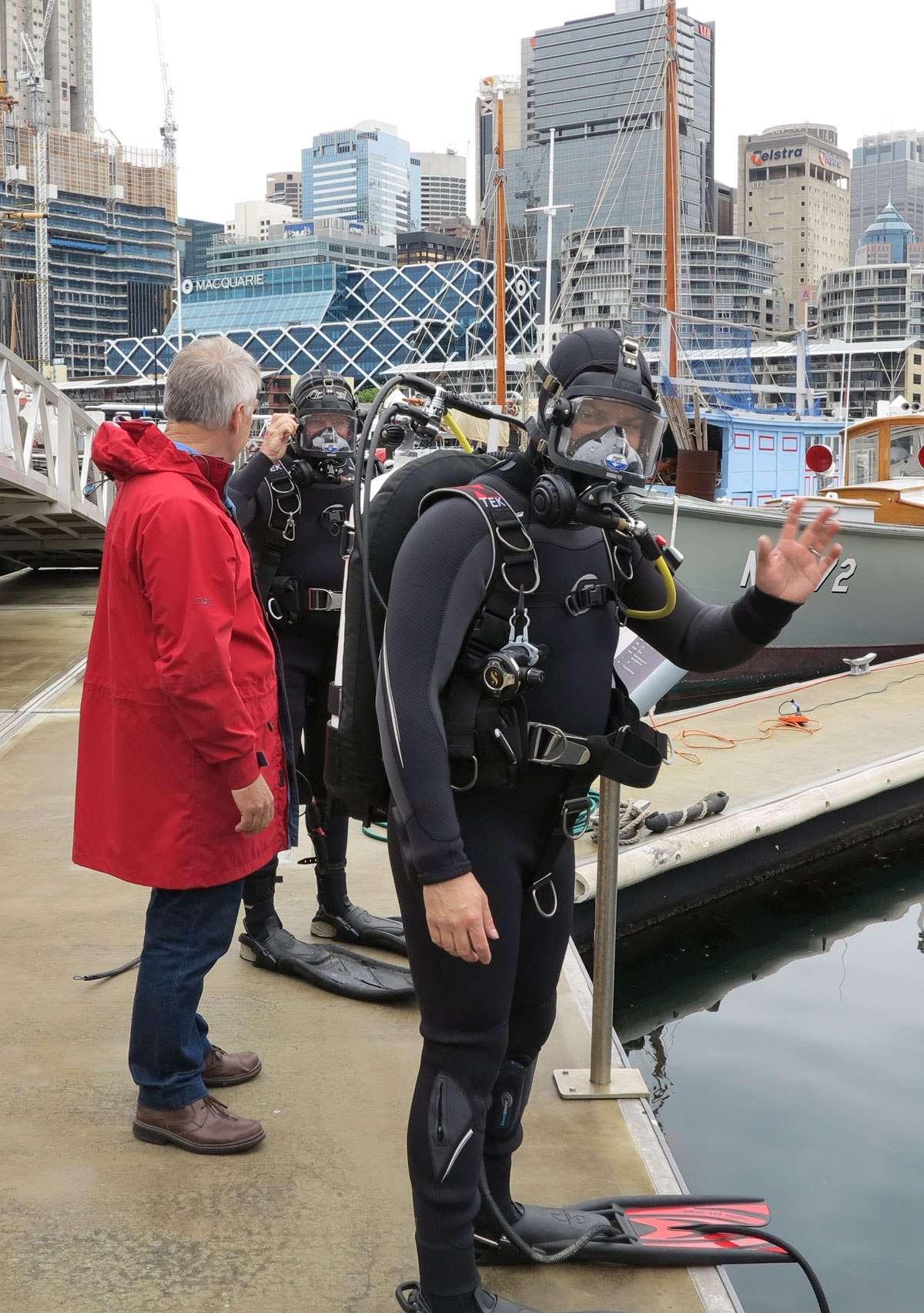 Dr Nigel Erkine assists James Hunter and Lee Graham prepare for the dive.