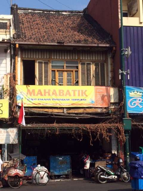 Dutch colonial architecture underneath the overlay of an Indonesian streetscape on Malioboro