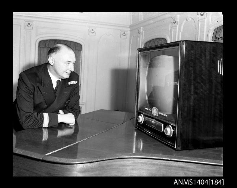 Man watching an AWA television on board the ship TAIPING Photo by Gervais Purcell, courtesy Leigh Purcell