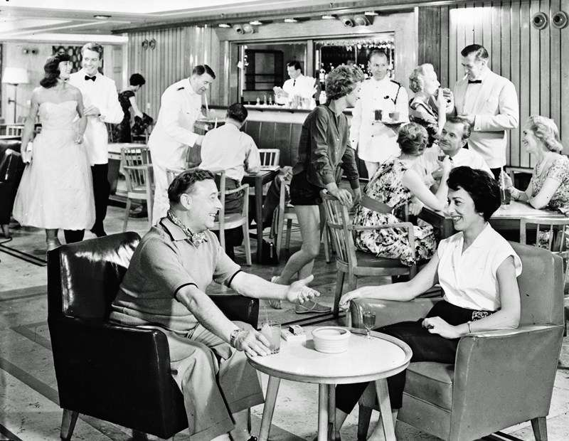 A vintage promotional photo of a crowd at a P&O bar.
