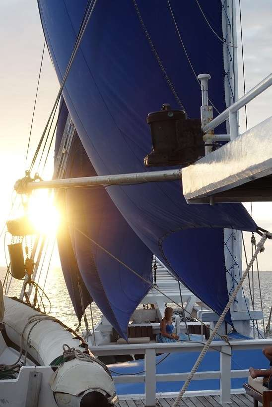 Photograph of sunset under sail on Ombak Putih