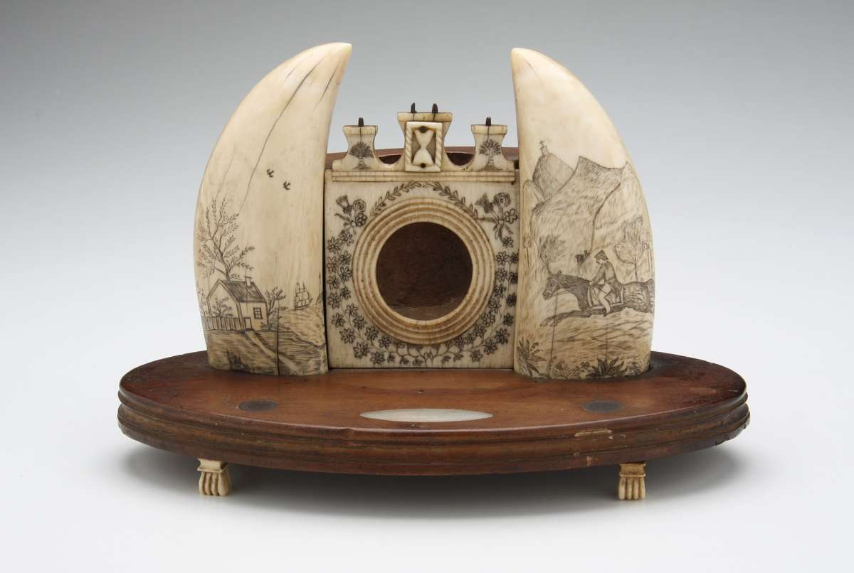 Fob watch stand with mounted whale teeth.