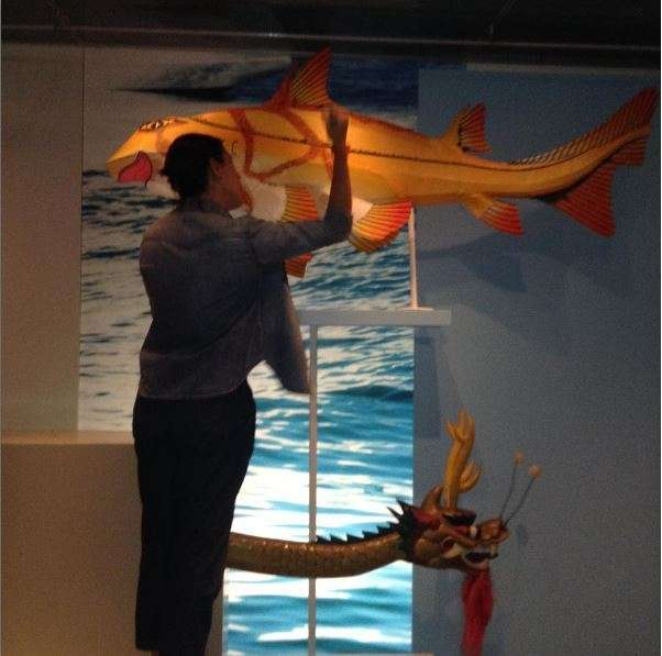 Registration staff remove a fish lantern from display. Image: ANMM.