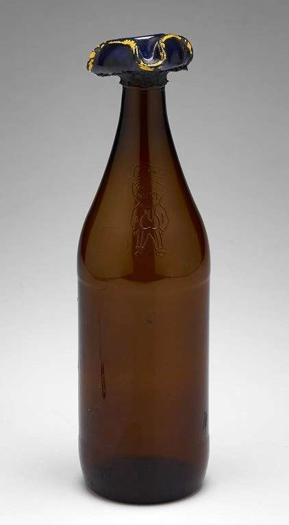 One of the accompanying beer bottles with a Captain Cook style hat