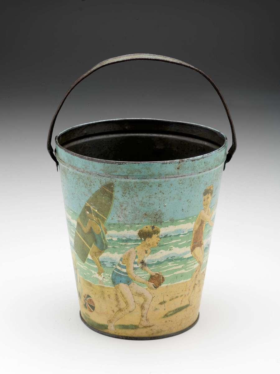 Child's toy sand bucket, manufactured by Arnotts Biscuits, circa 1930. ANMM Collection 00000166.