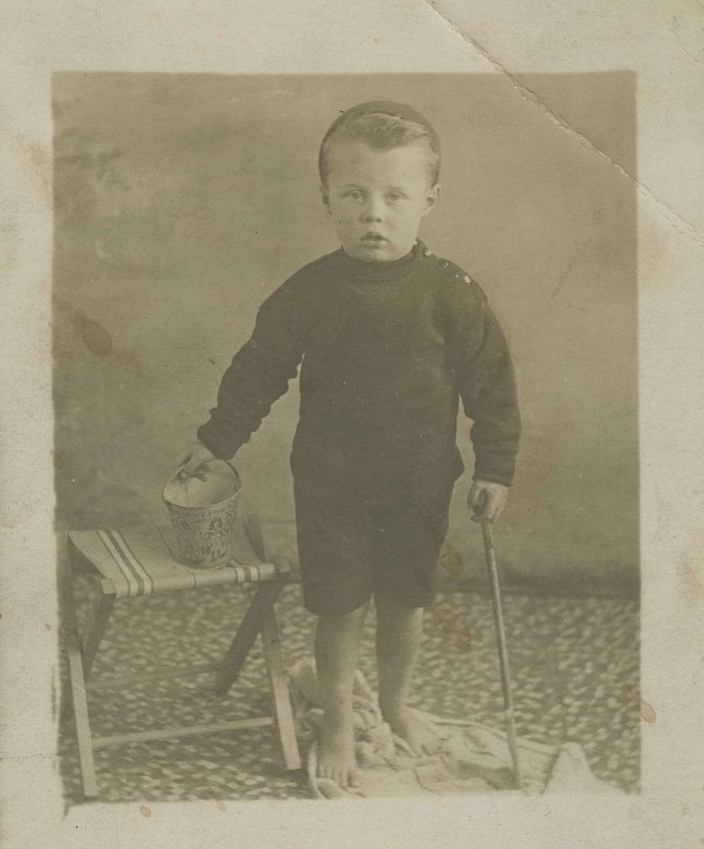 A young boy with a beach bucket. ANMM Collection ANMS1032[052].