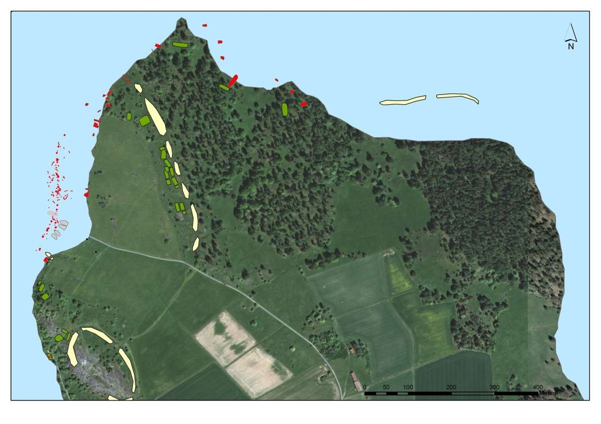 This map shows the reconstructed Viking Age shoreline. Stretching across the bottom of the harbor area, both above and below the clay sediment, were piles and timber remains from the large port facility (in red). The harbor area was surrounded by a line of large wooden piles (referred to as the 'pole wall') driven into the mud at a water depth of 6-8 meters. The pole wall stretched out to approximately 100 meters from the shore and connected with the ramparts on land. The pole wall marked the border of the city, functioned as a breakwater, protected ships from outside attack, and is presumed to have allowed for the collection of tolls. Sjöhistoriska Museet