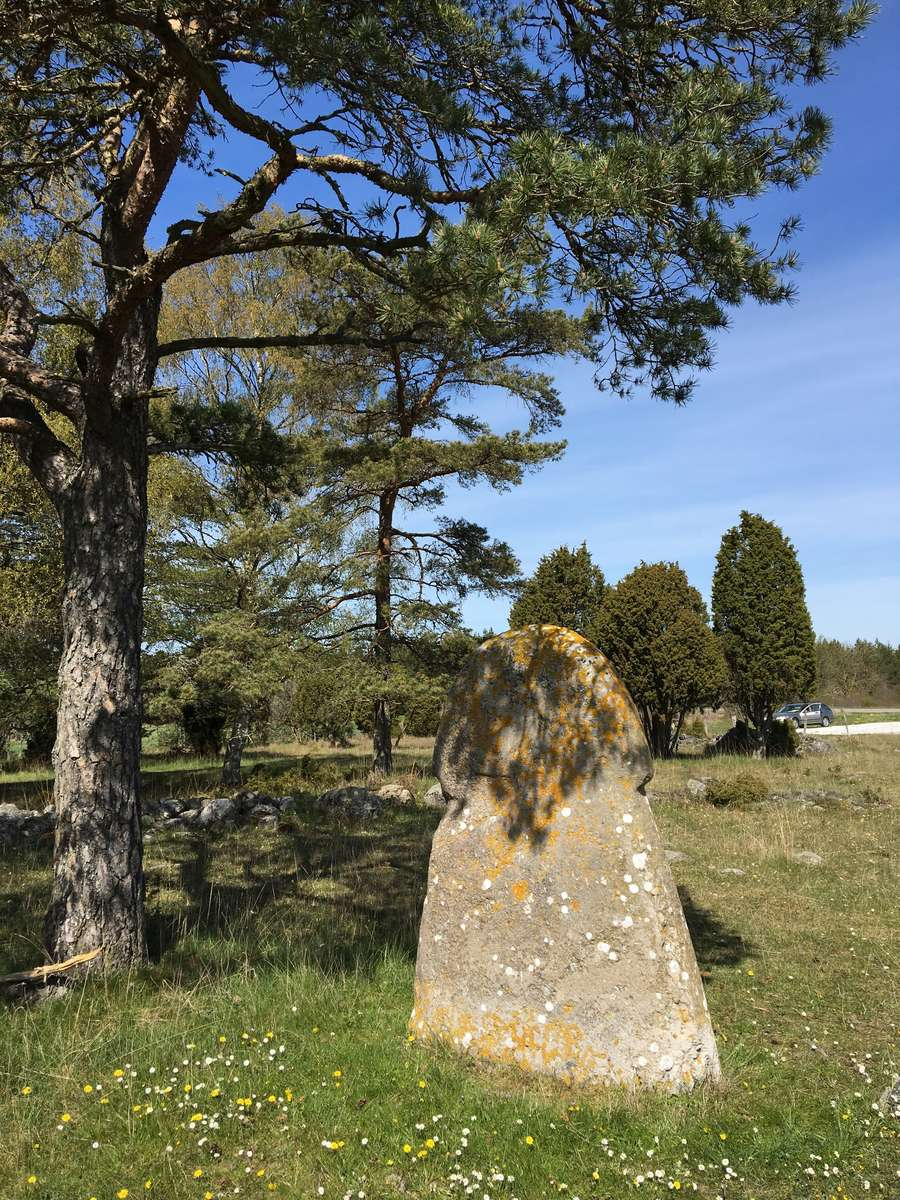 A weathered picture stone with indistinct traces of a ship, Gotland