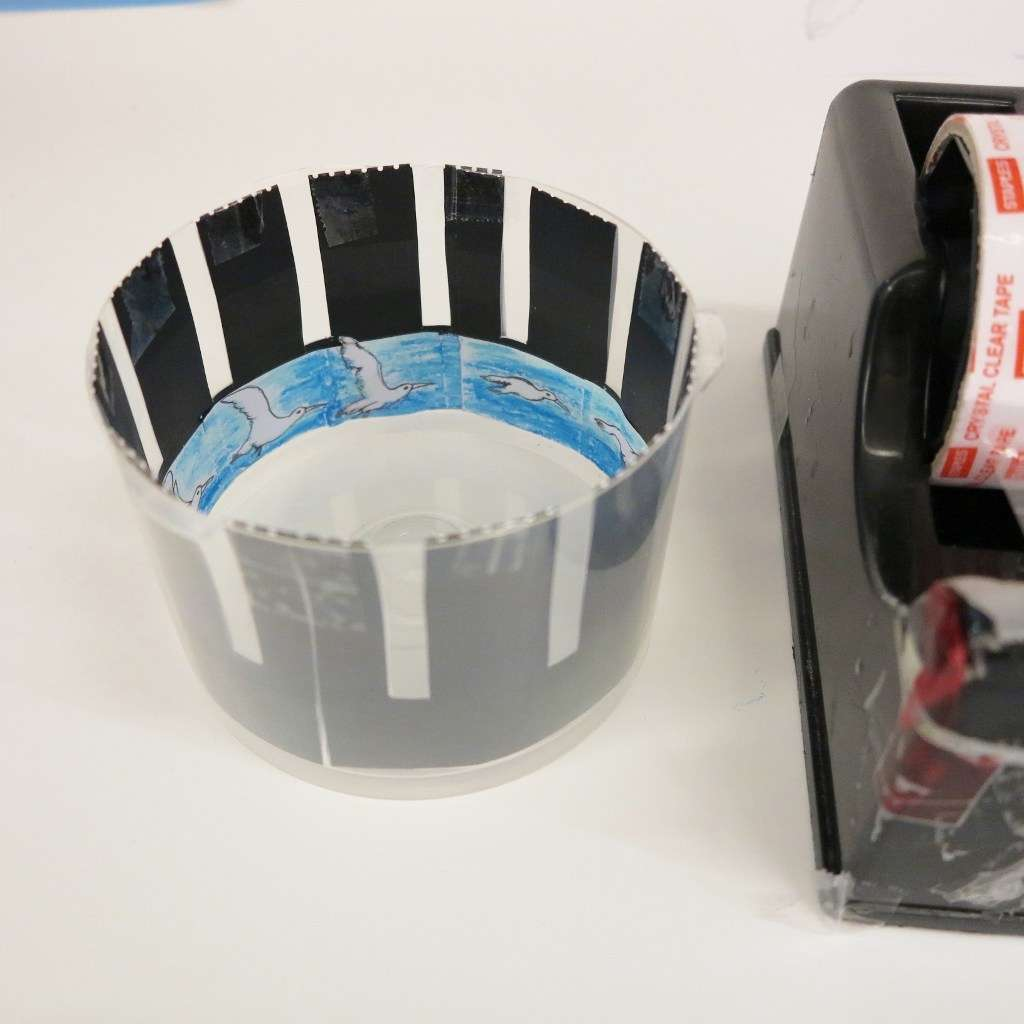Step 5: Tape your zoetrope to the inside of the container.