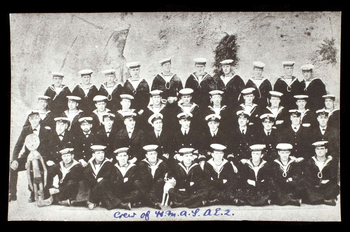 HMAS AE2's crew with mascot and dog, 1914-15. Image: Photographer unknown ANMM Collection 00051787.