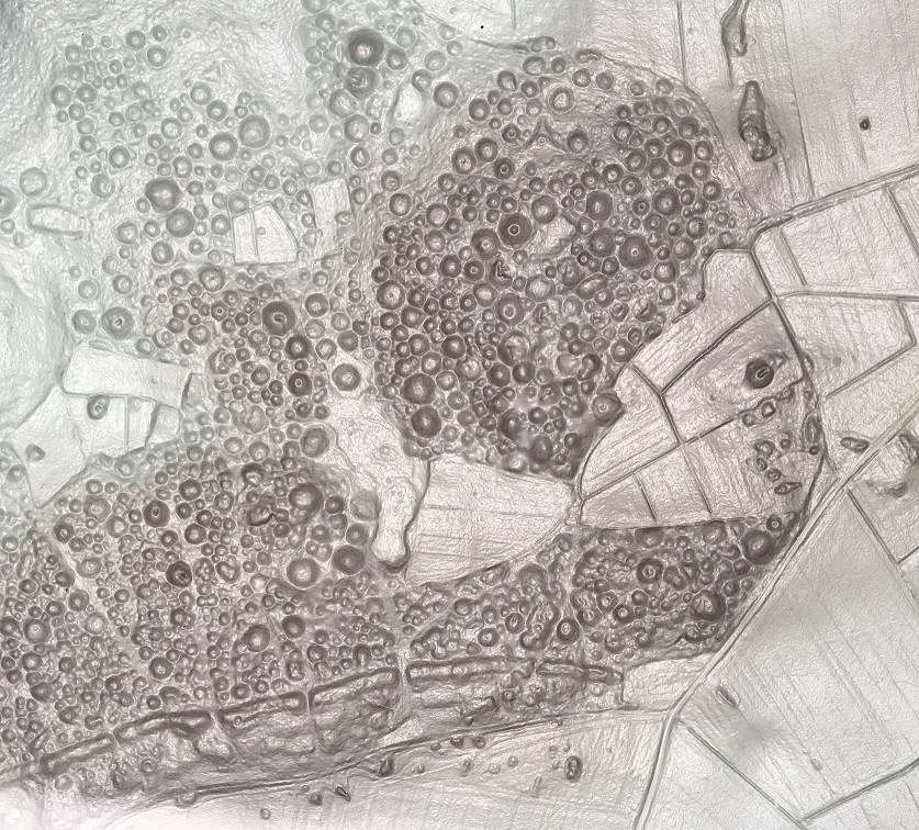 An aerial map showing the intense clustering of over 3,000 burial mounds