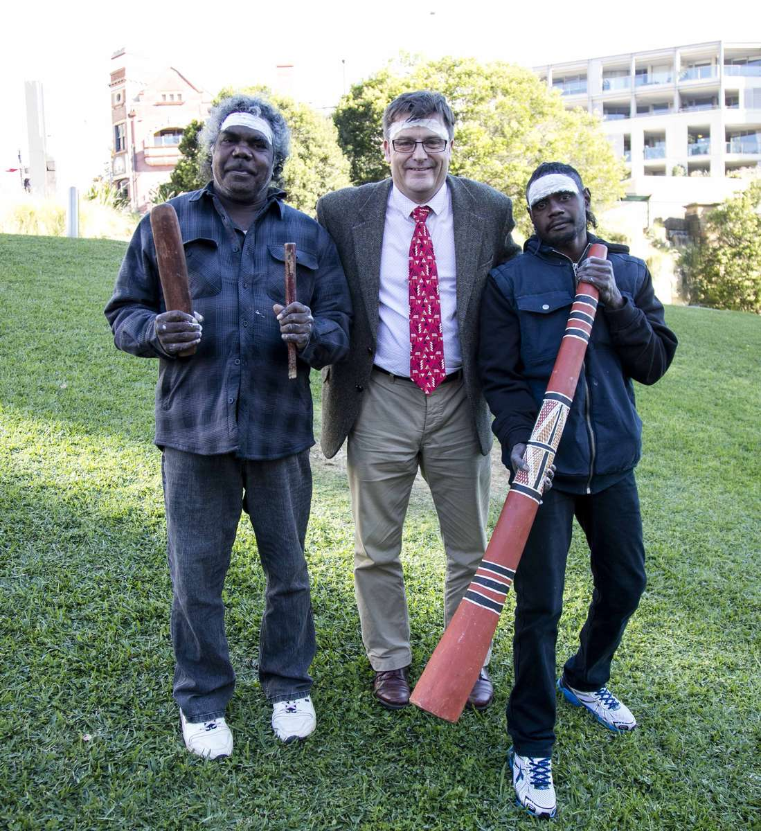 Donald Nuwandjali Marawili – designer of Blue Mud Bay Flag, Kevin Sumption, Director, Australian National Maritime Museum, Djuwakan Marika – didgeridoo player