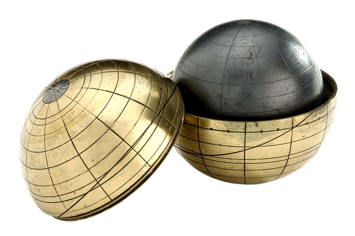 Terrella is a small, magnetised globe with the lines of longitude and latitude engraved on both the globe and the outer case. Image: National Maritime Museum, London.