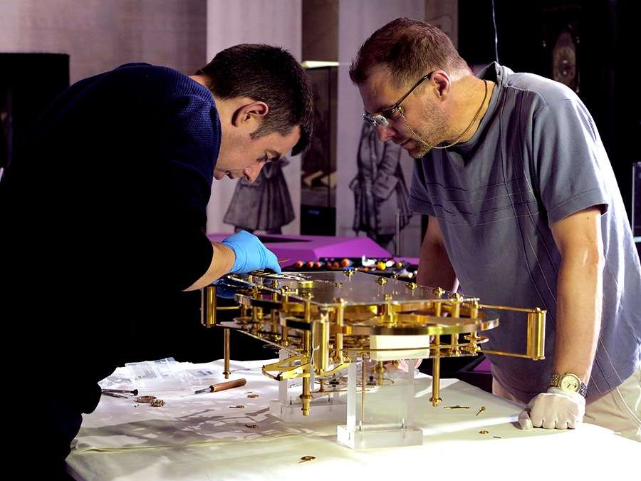 Master clockmakers Sean Martin and David Higgon travelled from London to assemble the H3 replica for the exhibition Ships, Clocks & Stars: the Quest for Longitude. Image: Kate Pentecost / ANMM.