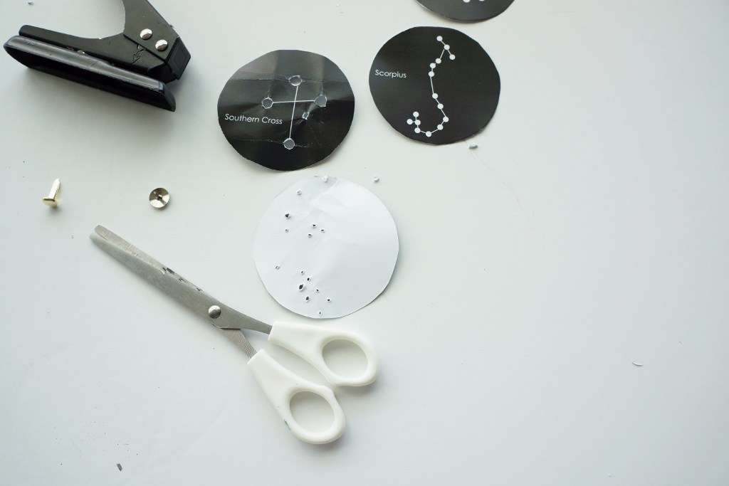 Use a hole punch or pin to make holes in the stars.