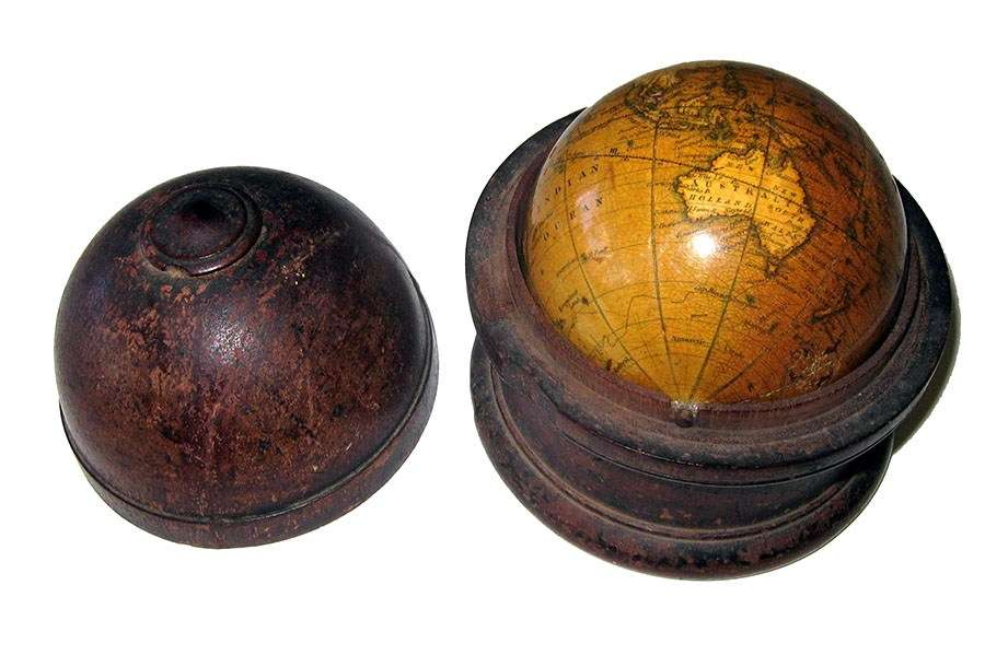A Terrestrial hand globe made by Newton & Son, 1851-1857. ANMM Collection: 00045821.