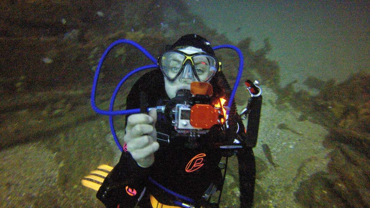 Archaeological diver Matilda Goslett with a GoPro camera equipped with colour correcting filters. Image: ANMM.