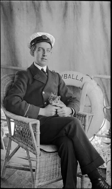 British India Line officer, nursing pet kitten, SS UMBALLA. Image: Samuel Hood / ANMM Collection 00020799.