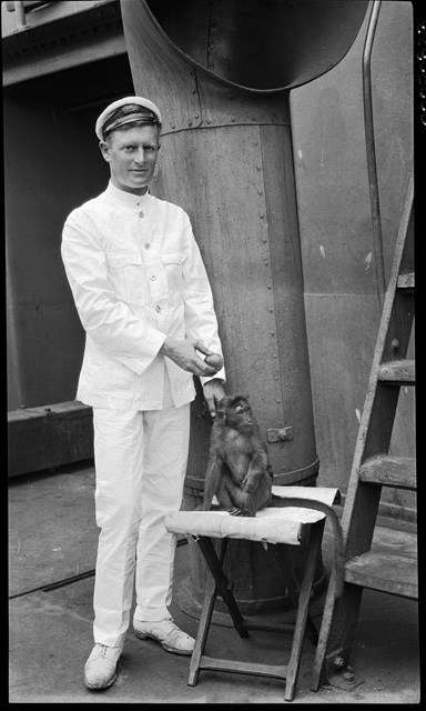 An officer in white uniform with a pet monkey. Image: Samuel Hood / ANMM Collection 00020838.
