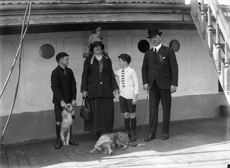 Group portrait of a family of four with two dogs and a parrot in a cage on the deck of the ship MOUNT STEWART, believed to be Captain M C McColm and his family. Image: Samuel Hood / ANMM Collection 00036760.