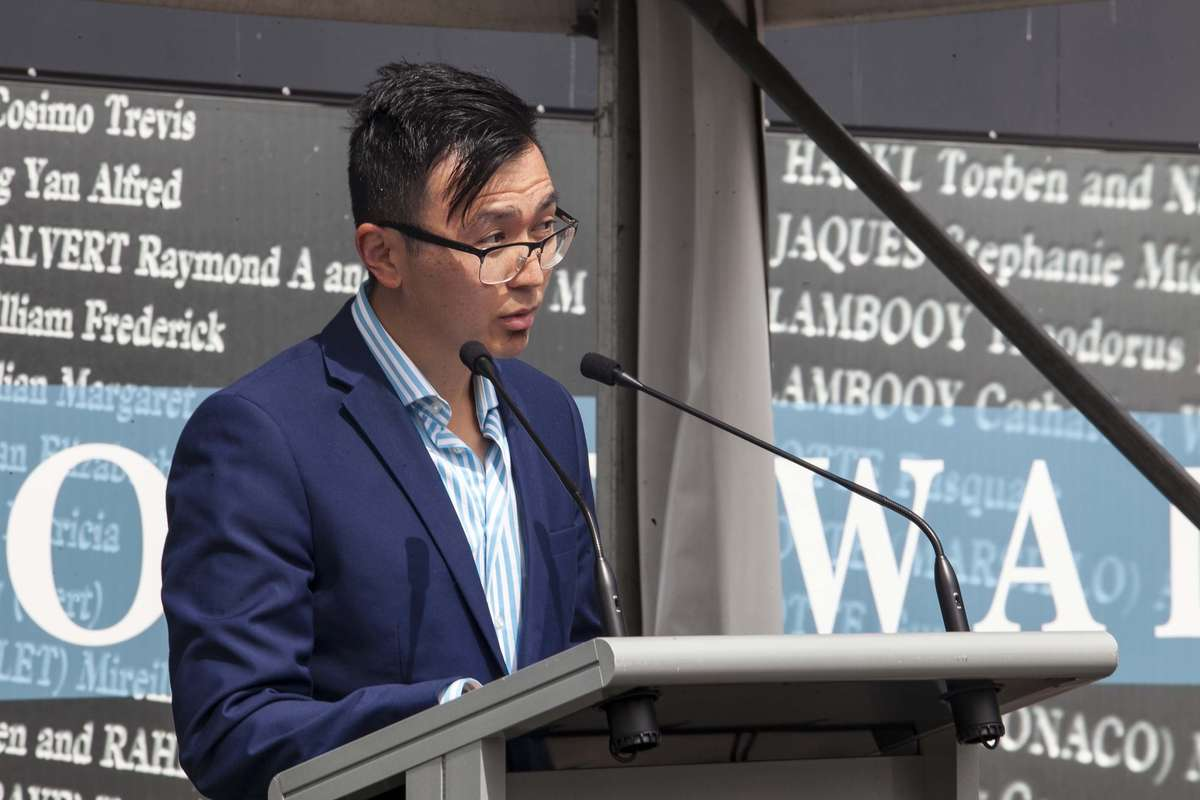 Lin Hu speaks at the Welcome Wall ceremony September 2016. Image: Andrew Frolows / ANMM.